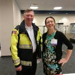 Buffalo Grove Fire Chief Mike Baker and IPELRA member Ioana Ardelean standing at the registration table