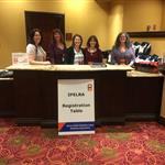 Rocella Rodgers, Roxanne Bonner, Chrissy Hoover, Michelle Robbins, Debi Stensland standing at registration table